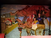 A mural replica of a portrait taken of Vinny's family in Sicily